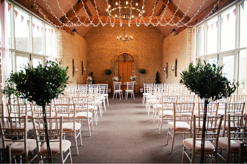 Civil ceremony wedding at Stratton Court Barn with straight aisle.