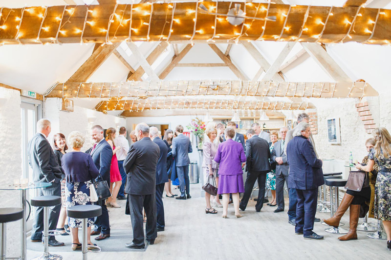 Weddings at Stratton Court Barn with people mingling in the bar area for drinks