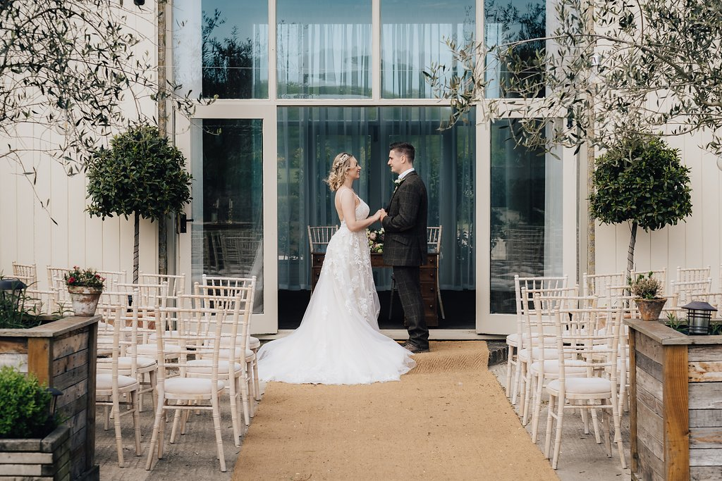 Weddings at Stratton Court Barn can have an outside ceremony with couple in doorway